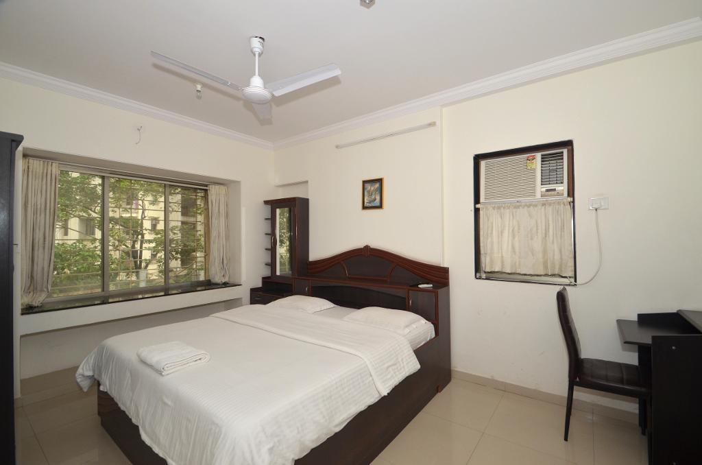 Qualified Service Apartments | Powai | Mumbai - Deluxe Bedroom