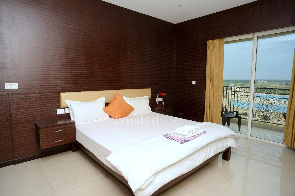 Qualified Service apartments in Oragadam, Chennai - Furnished Bedroom