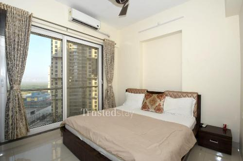 Master bedroom | Service Apartments in Ghansoli, Navi Mumbai