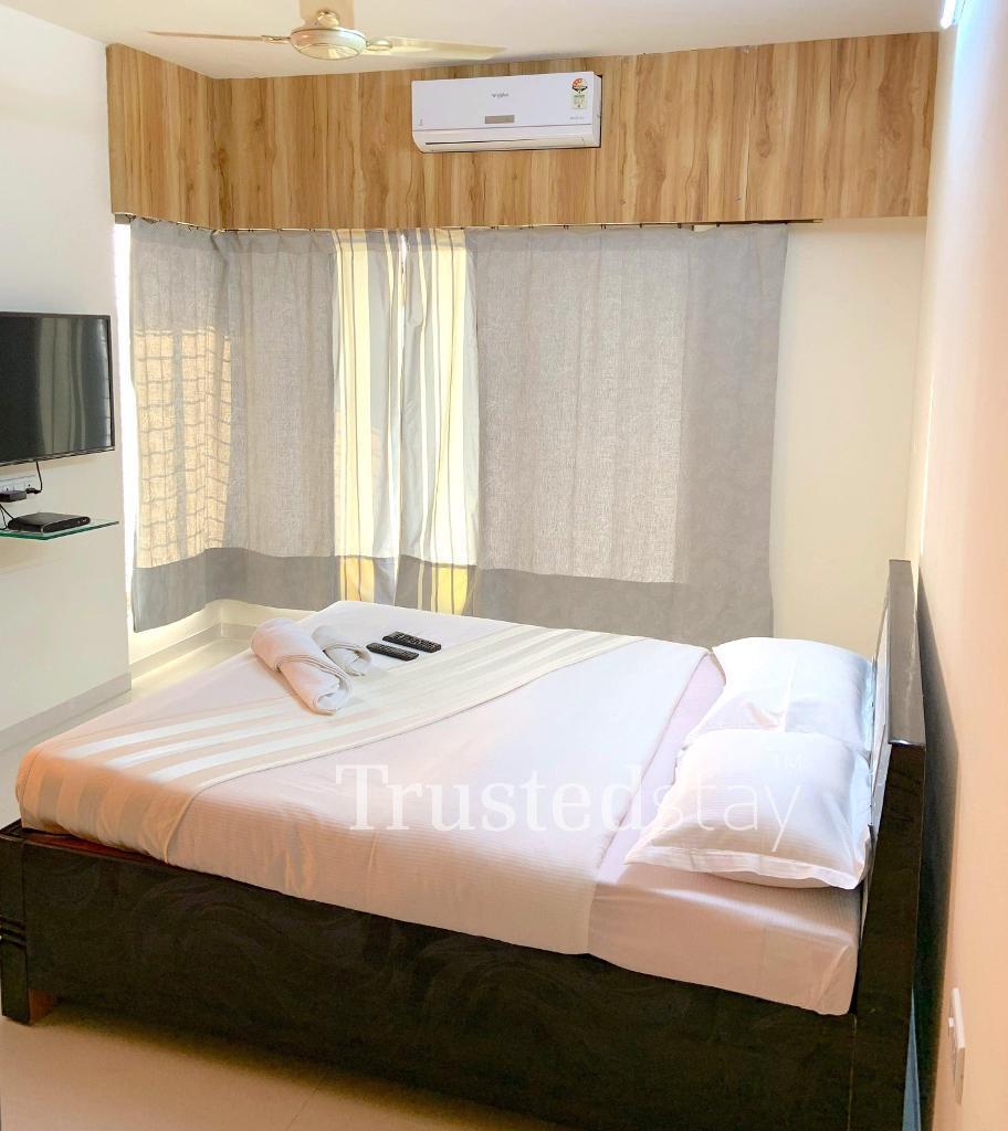 Bedroom at a Trustedstay property in Mumbai | Matoshree Pride ( PAREK1 )