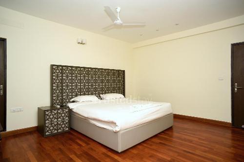TrustedStay Service Apartments in Mahindra World City, Chennai - Bedroom