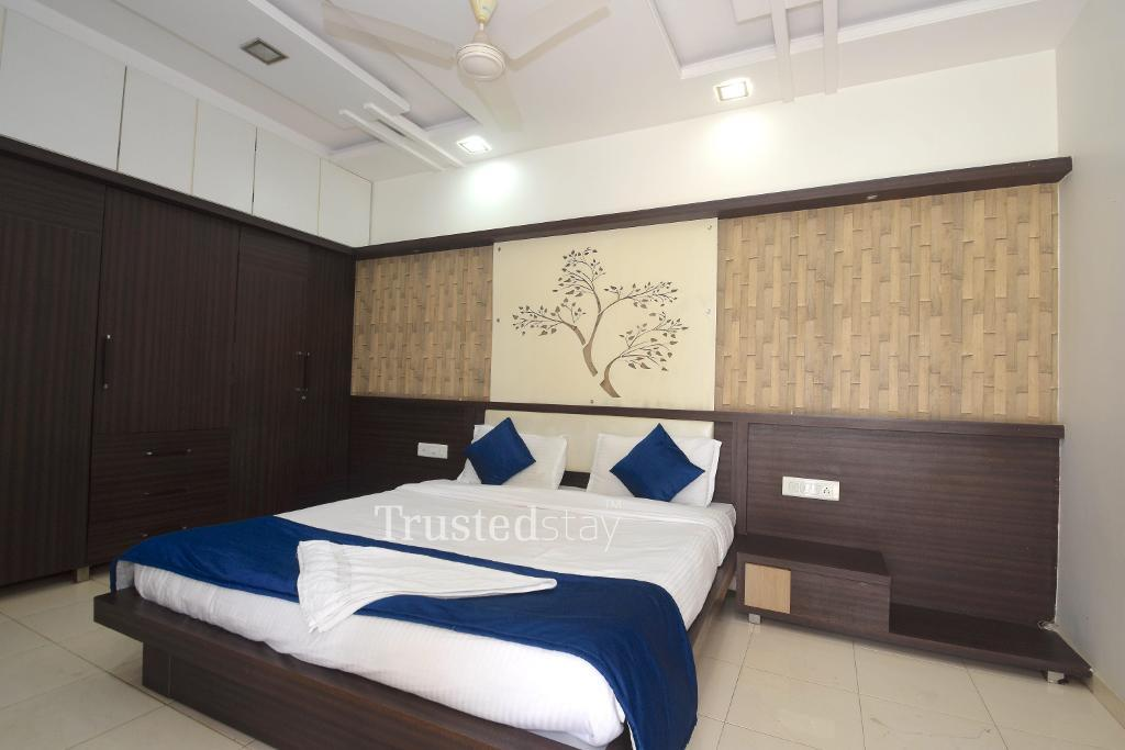 Bedroom at a Trustedstay property in Ahmedabad | Krishna Bunglows ( PRASR1 )