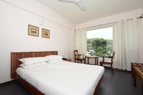 Service Apartments in Thevara , Cochin | Standard Bedroom