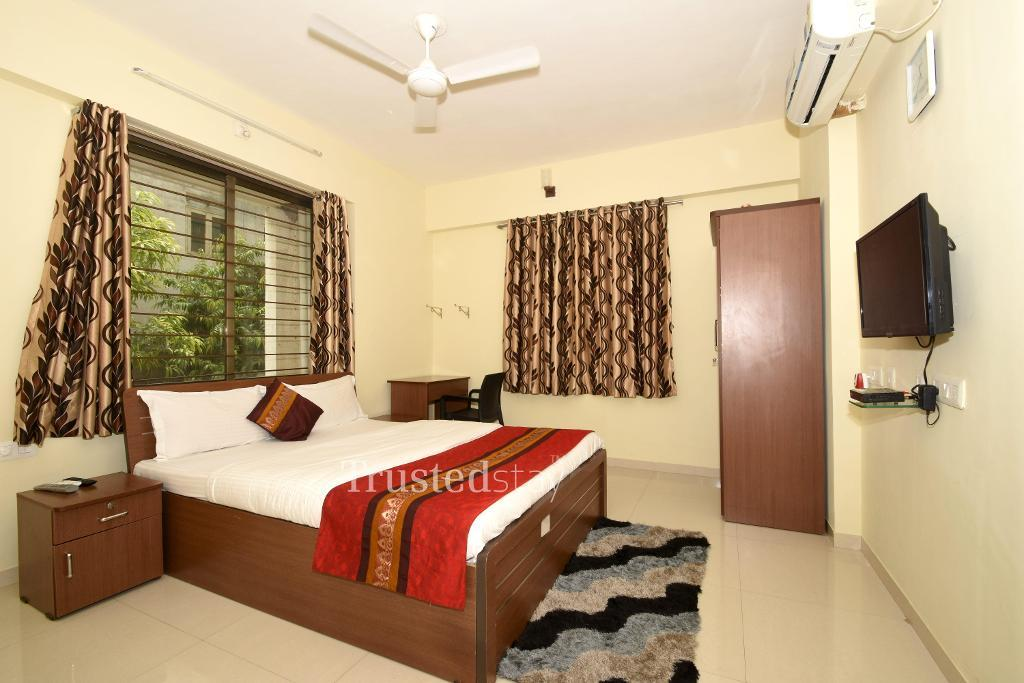 Bedroom at a Trustedstay property in Ahmedabad | *Achal Repose ( NAVMT1 )