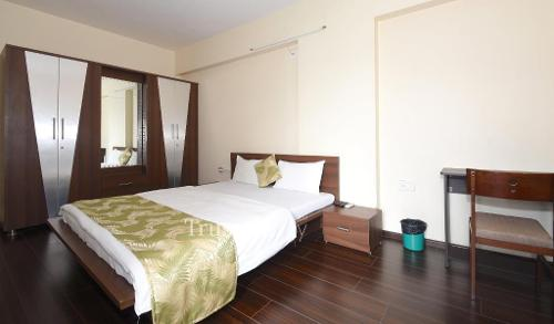 Service apartments in Makarba, Ahmedabad | Bedroom