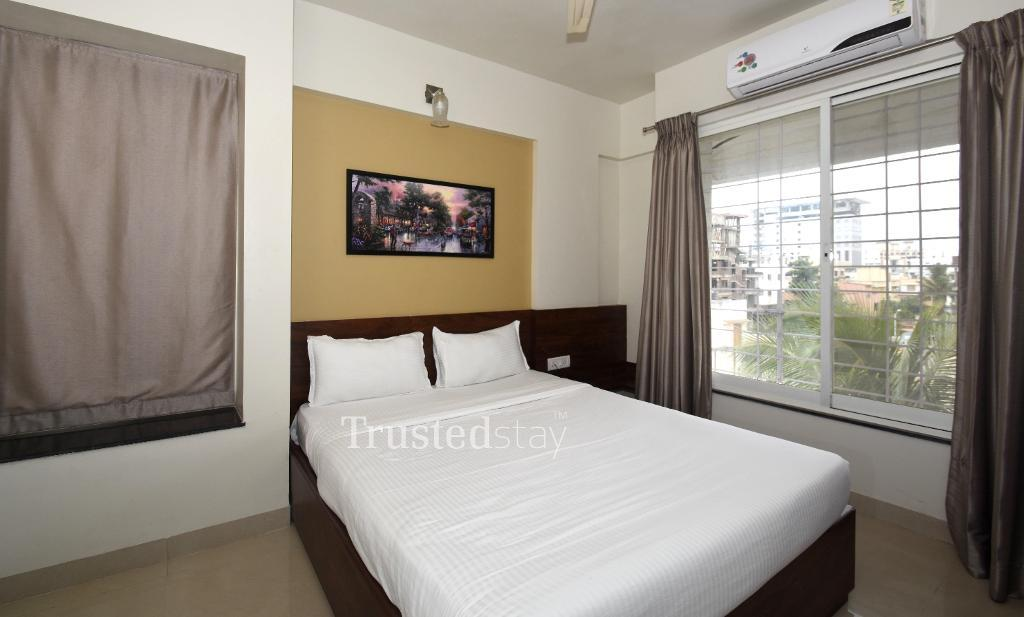 Bedroom at a Trustedstay property in Pune | Icon Bliss ( KHABP2 )