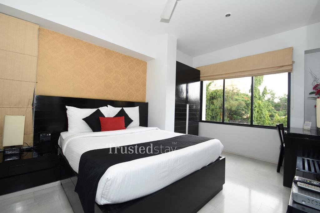 Master Bed Room | Trustedstay Service Apartments in Pune