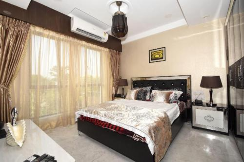 Service apartments in new town, Kolkata - Master Bedroom