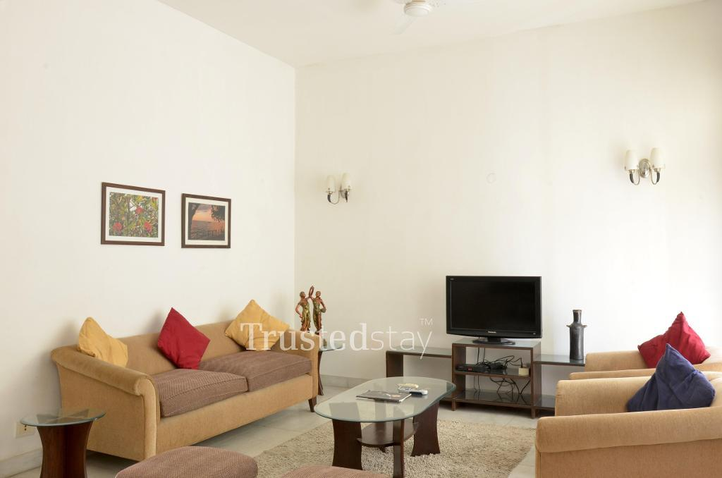 TrustedStay Service Apartments in Delhi - Furnished Living Room