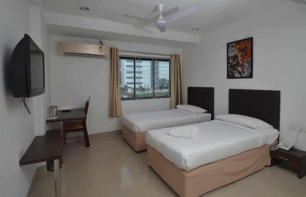 Service apartments in OMR, Chennai - Deluxe bedroom