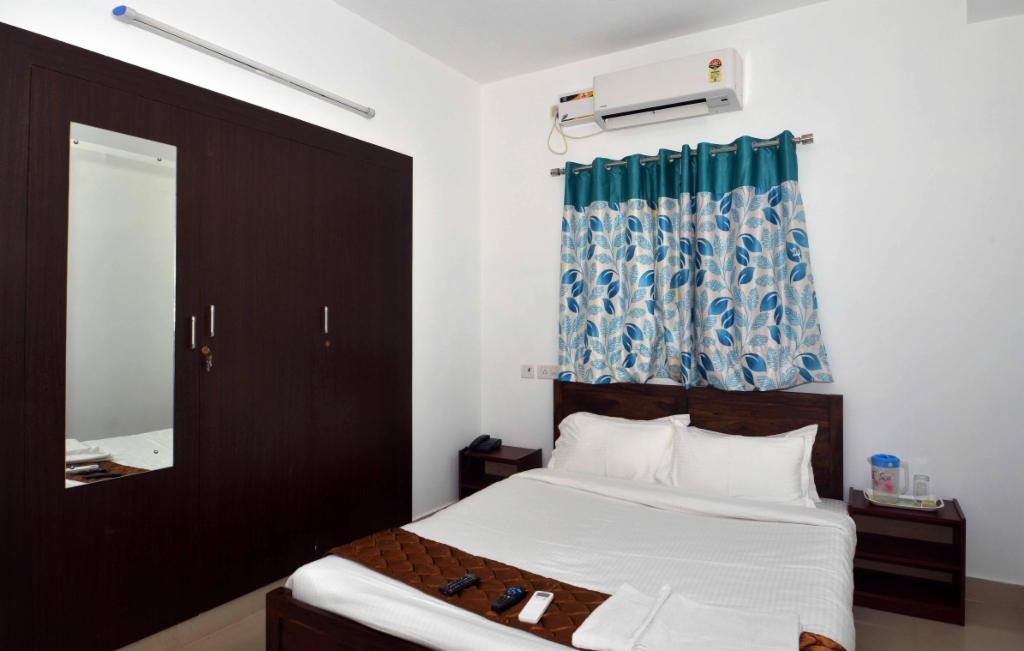 Service Apartments in Ramapuram, Chennai - Deluxe Bedroom