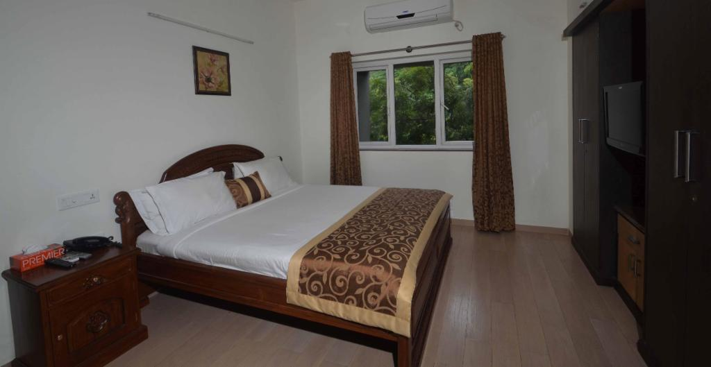 Service Apartments in Saidapet, Chennai - Deluxe Bedroom