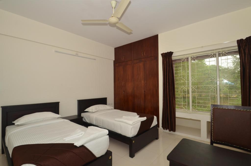Book Service apartments in Kakkanad, Cochin - Bedroom