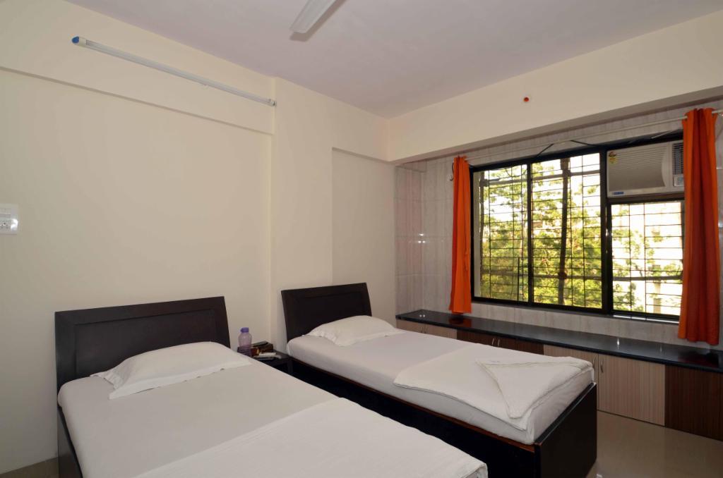 Service Apartments | J B Nagar | Mumbai - Deluxe Bedroom