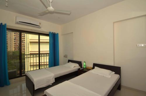 Service Apartments in Malad East | Mumbai - Deluxe Bedroom